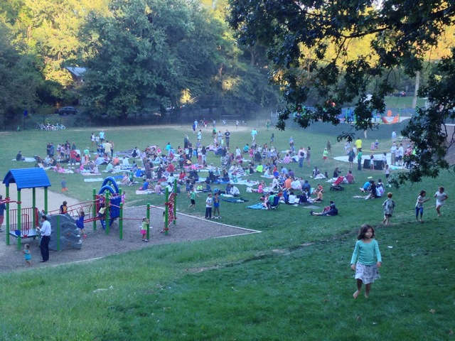 Back on the field for the back to school picnic. A few more dots of color, and we'd have a Seurat - or something like that.  Photo from Jamie B.